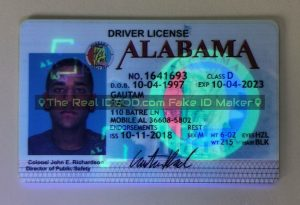 Alabama fake id under blacklight showing UV design