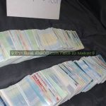 Hundreds of fake id cards laid out in two rows made by IDGod.