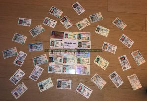 Many fake id cards displayed made by IDGod.
